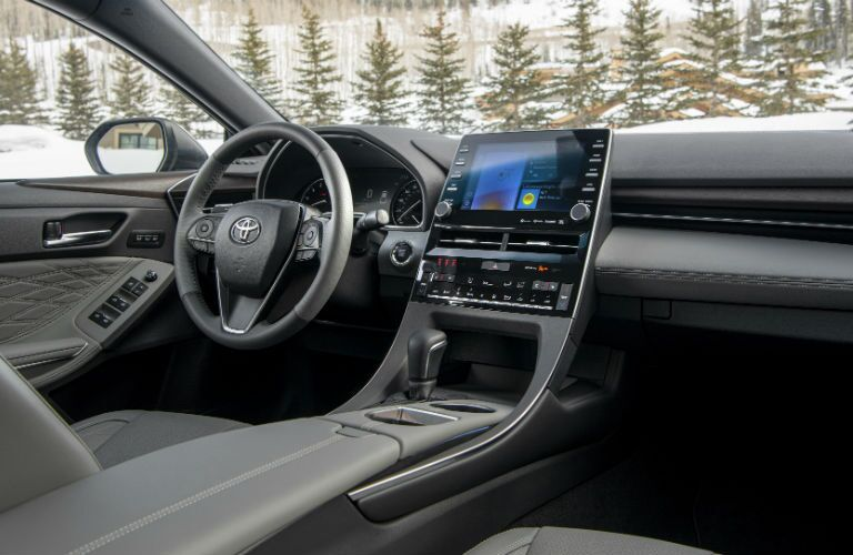 A photo of the dashboard and driver's cockpit in the 2021 Toyota Avalon.