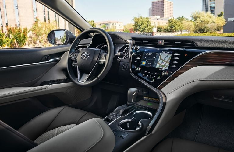 Interior view of the front seating area inside a 2020 Toyota Camry