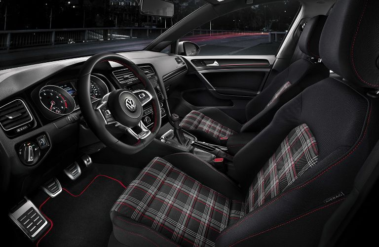 Front two plaid seats inside 2019 VW Golf GTI