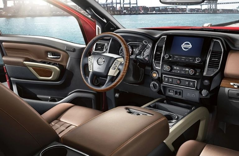 Interior view of the front seating area inside a 2021 Nissan TITAN