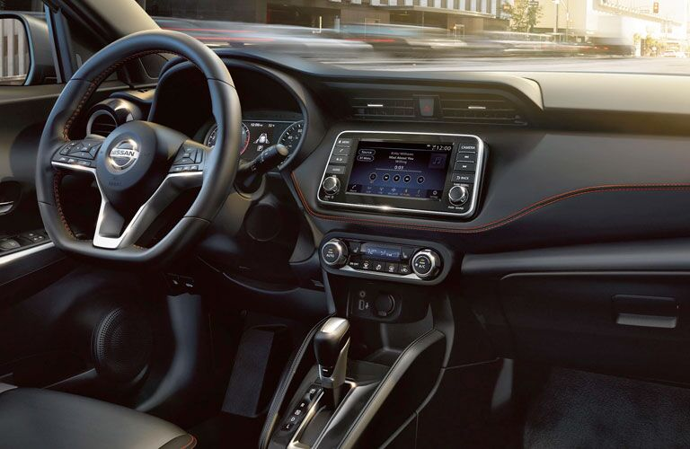 Front interior steering wheel and touchscreen display on the 2020 Nissan Kicks
