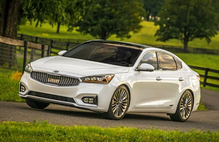 Exterior view of the front of a white 2019 Kia Cadenza