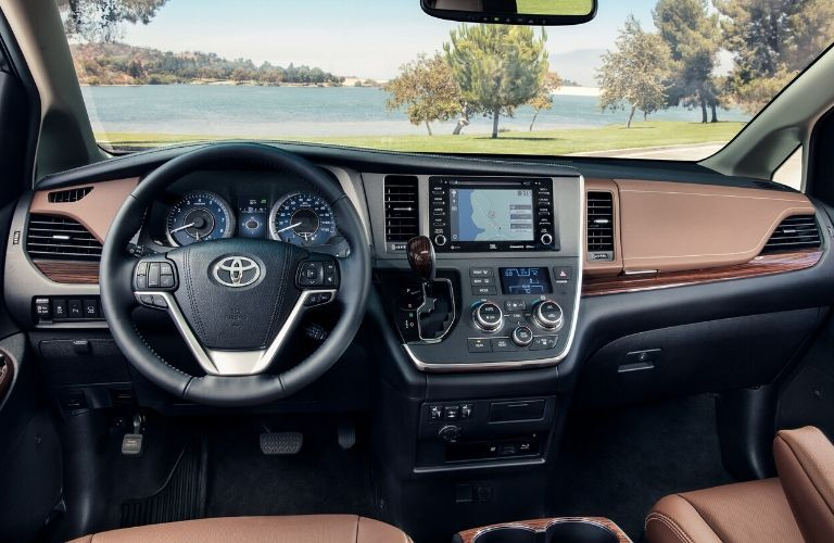 Interior view of the steering wheel and touchscreen inside a 2020 Toyota Sienna