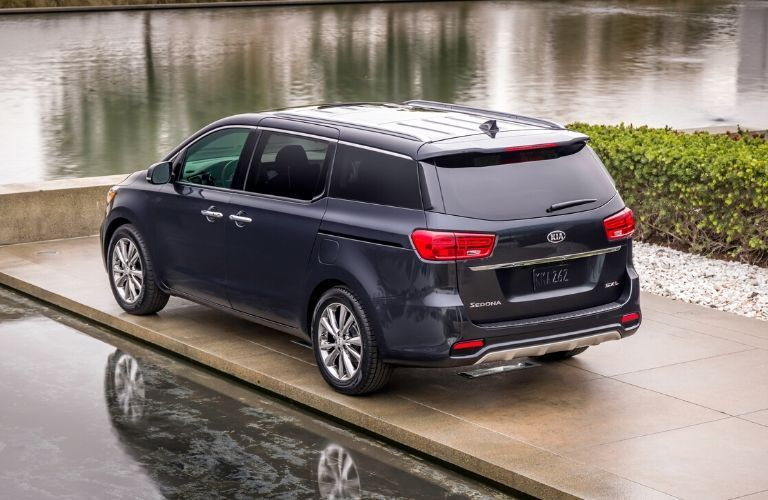 Exterior view of the rear of a blue 2020 Kia Sedona