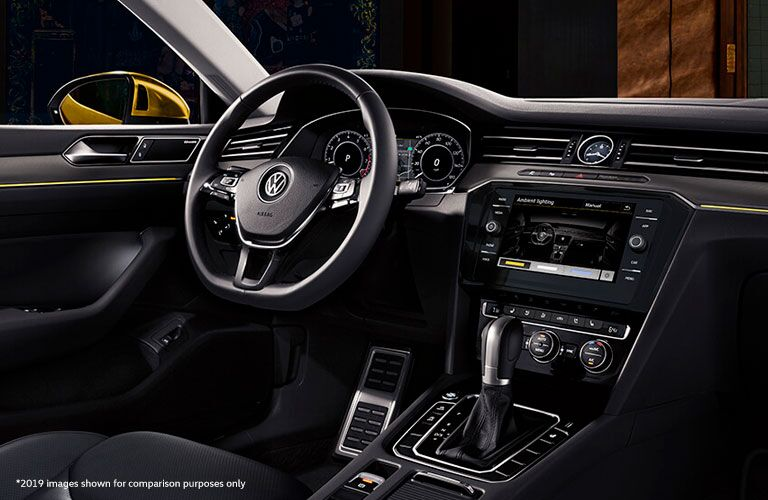 Interior view of the steering wheel and touchscreen display inside a 2020 Volkswagen Arteon