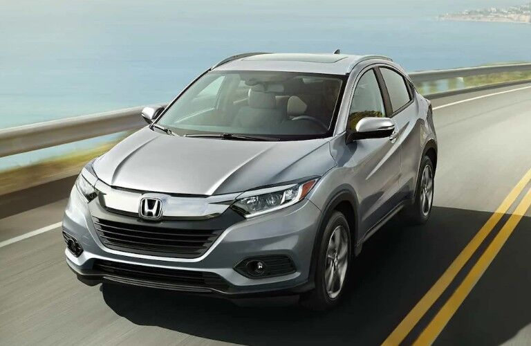 Front driver angle of a grey 2019 Honda HR-V driving down a road