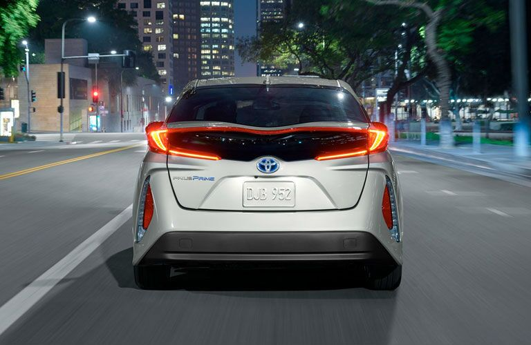 Silver 2020 Toyota Prius Prime Rear Exterior and Taillights on City Street at Night