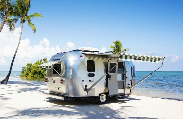 The 2019 Airstream Tommy Bahama parked on the beach.
