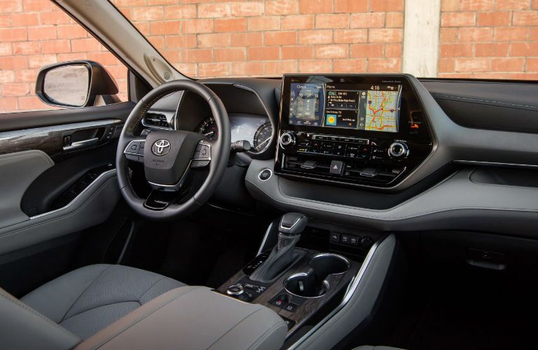 A photo of the driver's cockpit in the 2021 Toyota Highlander.