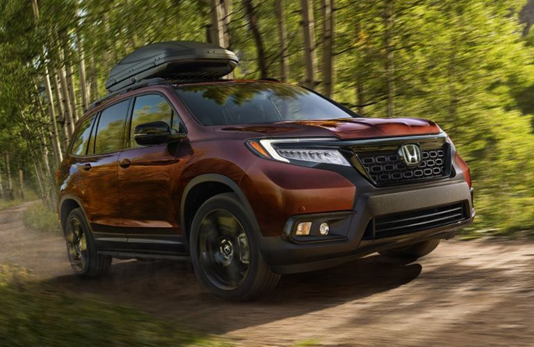 2021 Honda Passport driving through forest