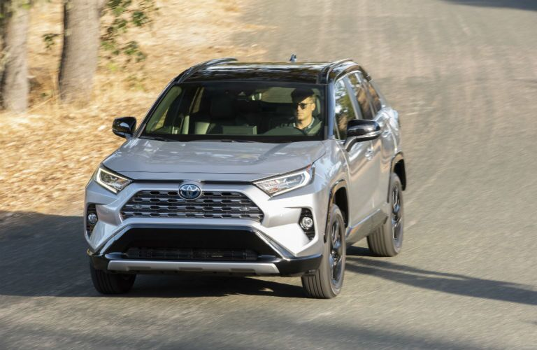A head-on photo of the 2020 Toyota RAV4 Hybrid on the road.