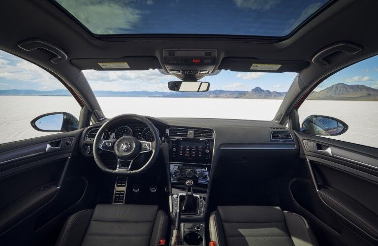 The front interior inside a 2021 Volkswagen Golf GTI.