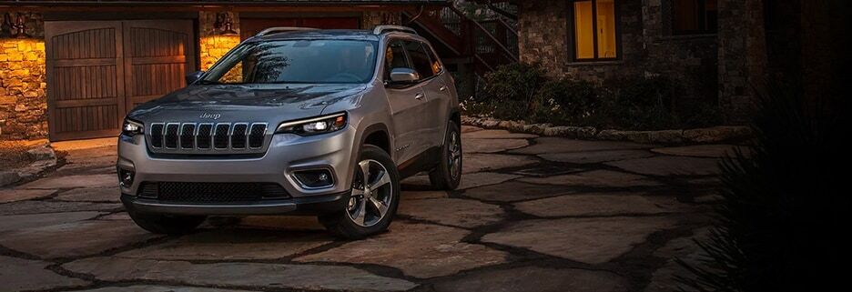Gray 2019 Jeep Cherokee parked in front of a house