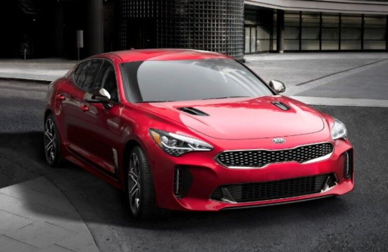 Red 2021 Kia Stinger parked on road