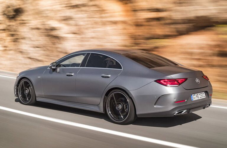 Profile view of silver 2019 Mercedes-Benz CLS driving on mountainous road