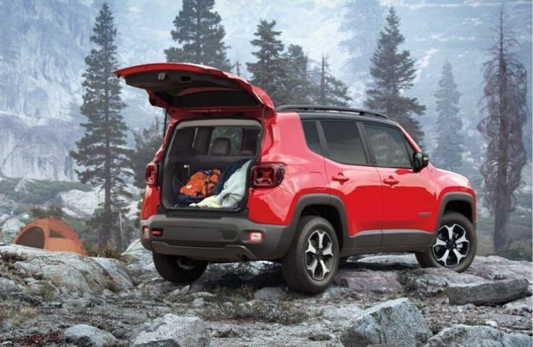 Exterior view of the rear of a red 2020 Jeep Renegade with the rear hatch open