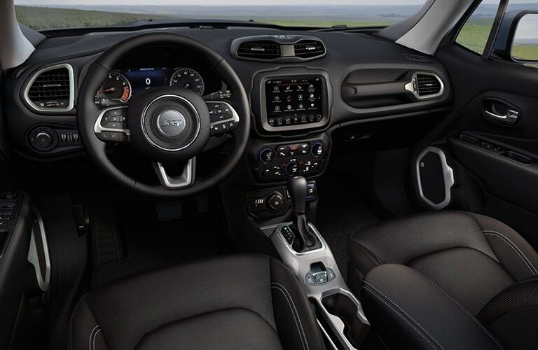 A front image of the steering wheel and center console inside a 2020 jeep Renegade.