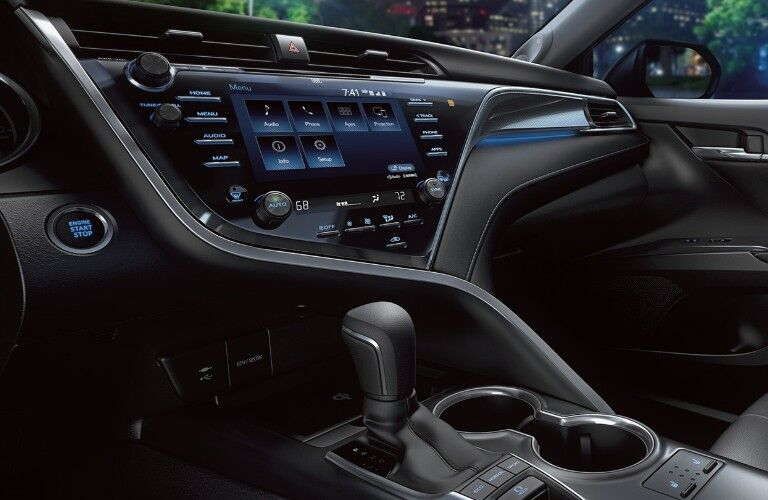 Close up of the touchscreen display and gear shift knob inside the 2020 Toyota Camry