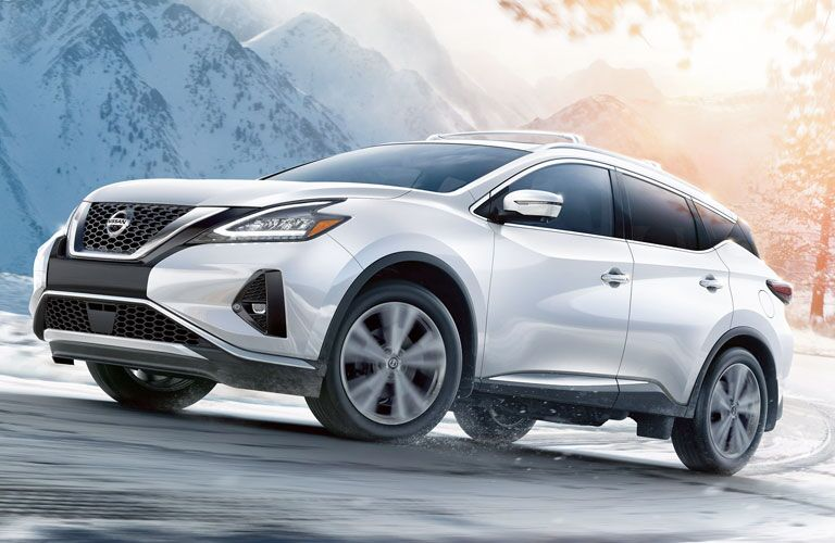 White 2020 Nissan Murano driving on a snowy mountain road