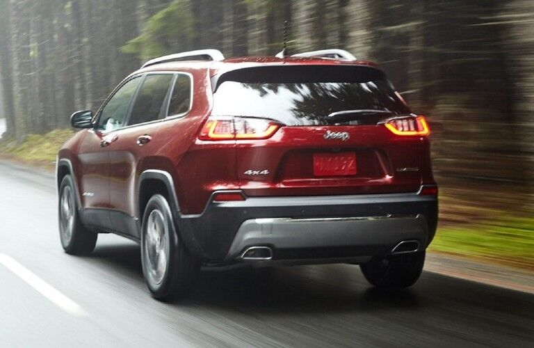 A rear view of a red 2021 Jeep Cherokee.