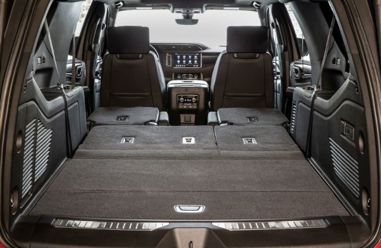 2021 GMC Yukon Denali with hatch open and two rows of seats folded flat