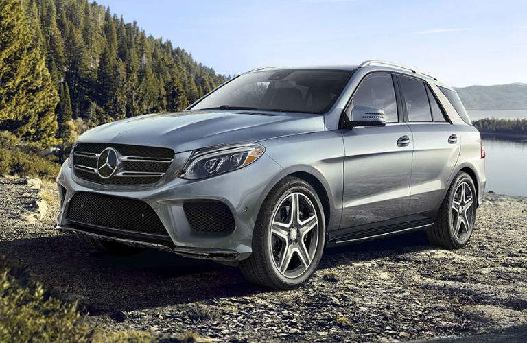 A front left quarter photo of the 2018 Mercedes-Benz GLE parked by a lake.
