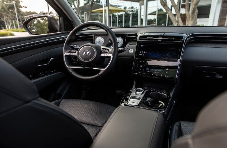 A photo of the driver's cockpit in the 2022 Hyundai Tucson.