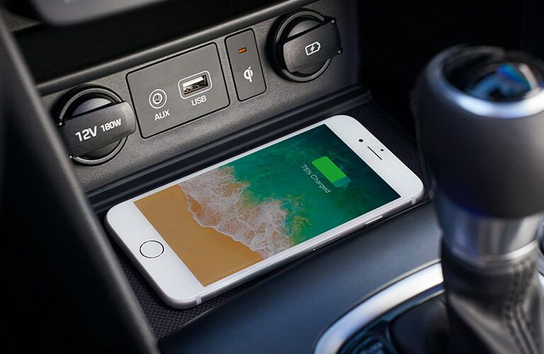 Smartphone on a wireless charging tray in a 2020 Hyundai Kona