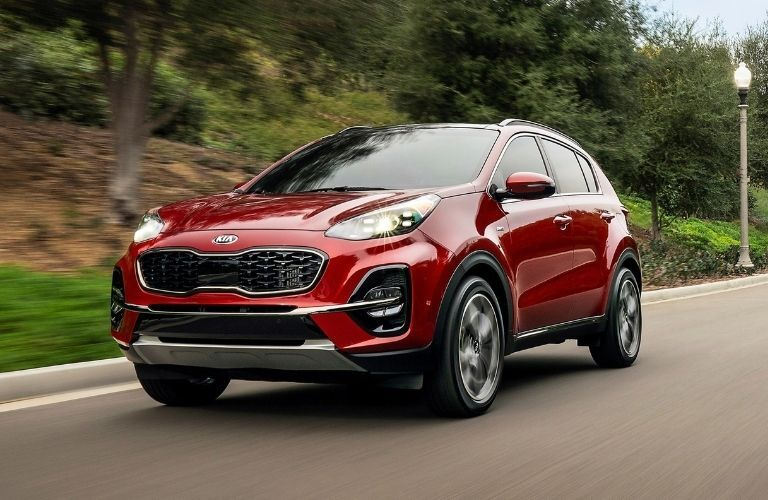 Exterior view of the front of a red 2021 Kia Sportage