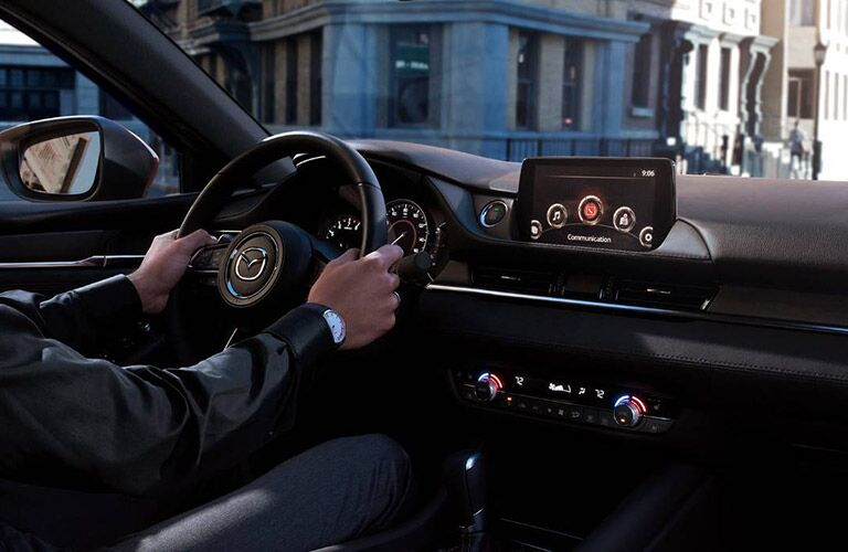 Hands gripping steering wheel inside 2019 Mazda6