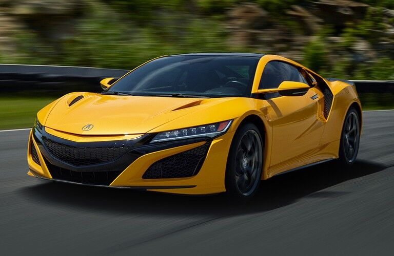 2020 Acura NSX yellow exterior front driver side on track