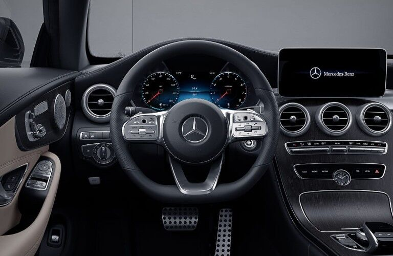 Close up of the steering wheel inside the 2020 Mercedes-Benz C-Class Coupe