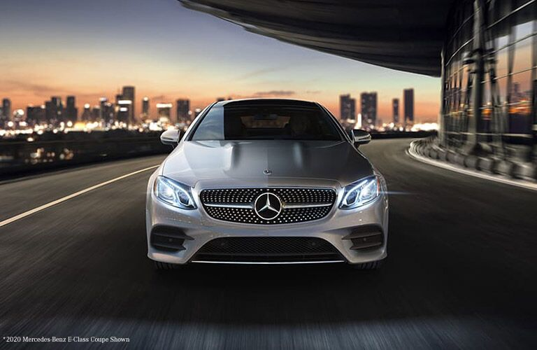 2021 MB E-Class Coupe exterior front fascia in city at dusk