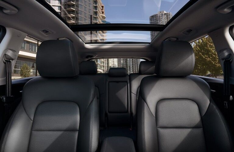 Angle from the front of a 2020 Hyundai Tucson showing the seats and sunroof
