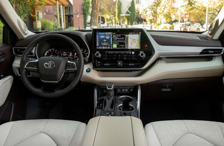 A photo of the driver's cockpit and dashboard in the 2021 Toyota Highlander.
