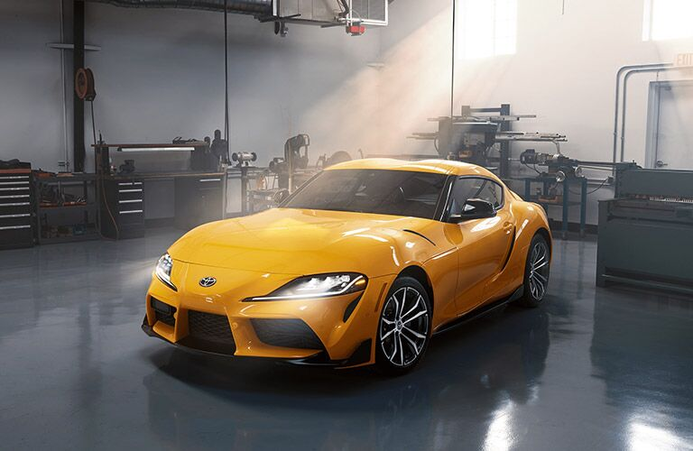Exterior view of the front of a yellow 2021 Toyota Supra