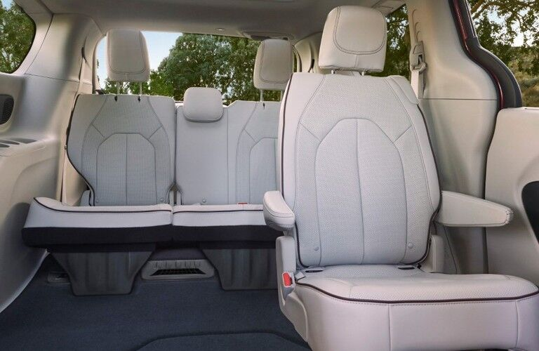 The interior of the second and third row seating inside a 2020 Chrysler Pacifica.