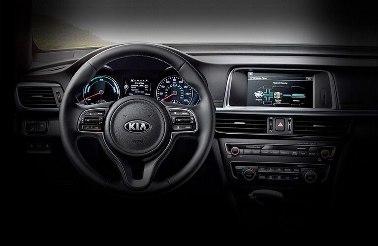 Interior view of the steering wheel and touchscreen display inside a 2020 Kia Optima