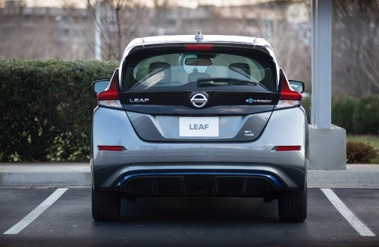 The rear side of a gray 2021 Nissan Leaf.