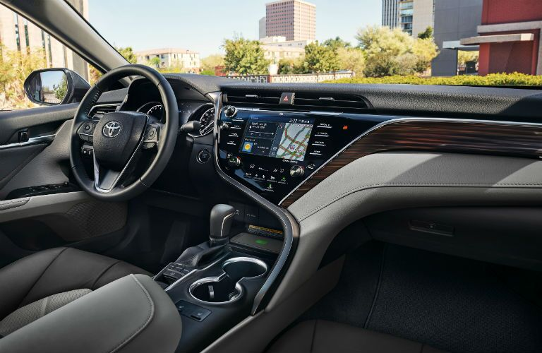 The front seating and steering wheel inside the 2020 Toyota Camry.
