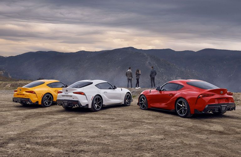 Exterior view of the rear of three 2020 Toyota Supra models
