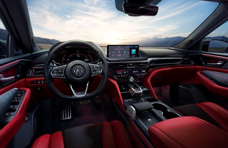 A photo of the driver's cockpit and dashboard in the 2022 Acura MDX.
