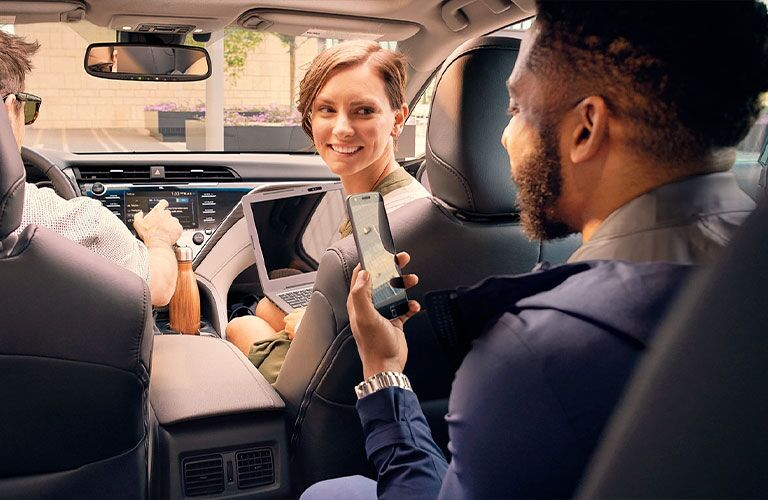 people inside the 2021 Toyota Camry Hybrid