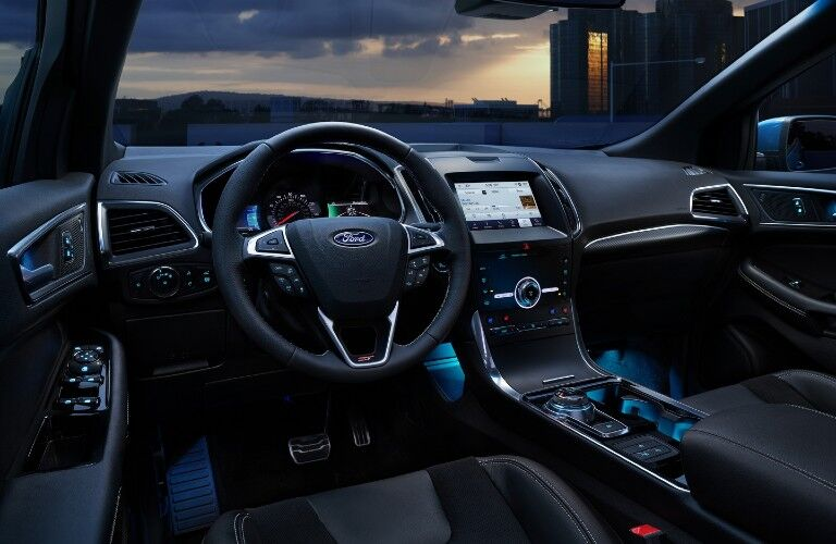 Front interior of the 2020 Ford Edge with blue ambient lighting