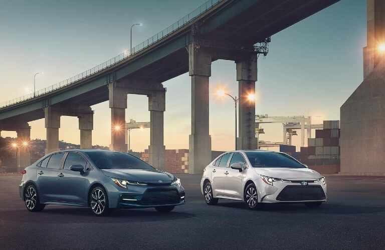 Two 2021 Toyota Corolla models under a bridge
