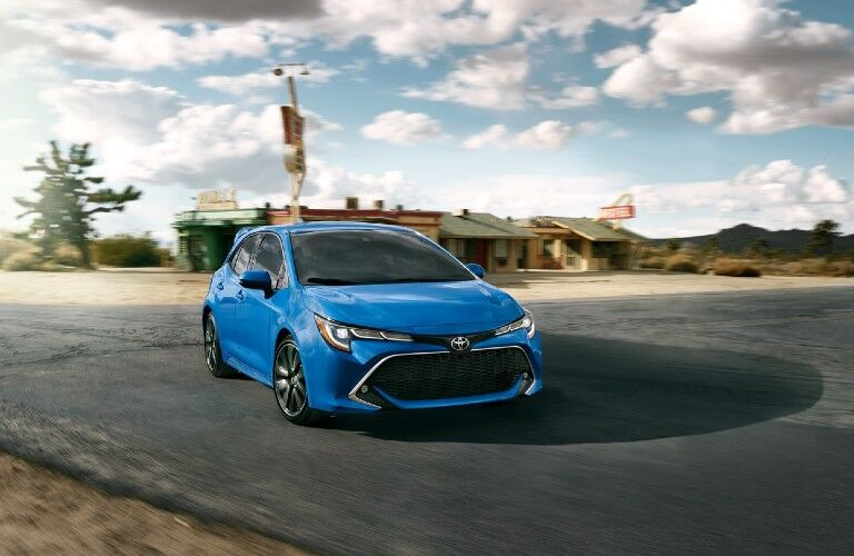 Exterior view of the front of a blue 2020 Toyota Corolla Hatchback