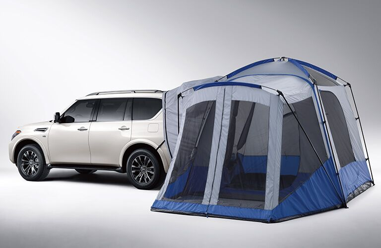 A tent attached to the back of a white 2019 Nissan Armada