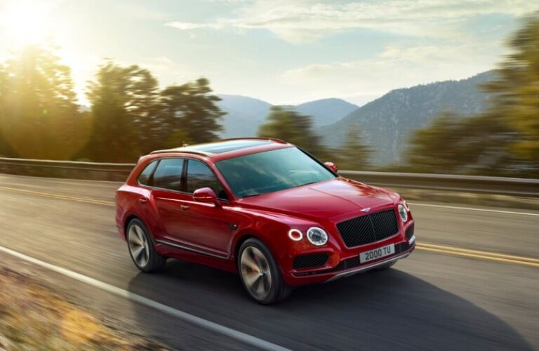 Side view of a red 2019 Bentley Bentayga