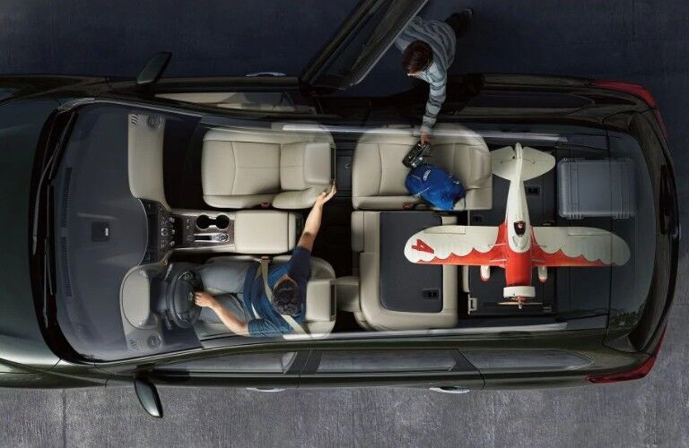 Aerial angle of the inside of the 2020 Nissan Pathfinder with seats down and a toy airplane inside