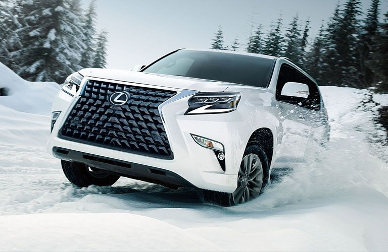 white 2020 Lexus GX driving through the snow